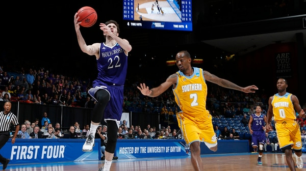 First Four: Holy Cross holds off Southern