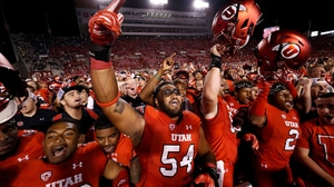 College Football: Utah wins Holy War vs...