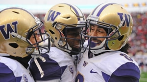 College Football: Washington victorious in...