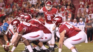 College Football: Arkansas defeats rival Ole Miss