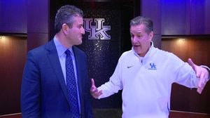 A phone call from Louisville added green to Kentucky's locker room
